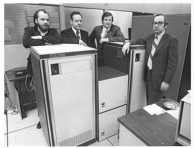 4-a-men-in-suits-big-computer.jpg